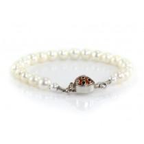 Rafinată brățară de perle naturale South Sea cu rafinat sistem de închidere stilizat sub forma unei buburuze din argint emailat | Japonia