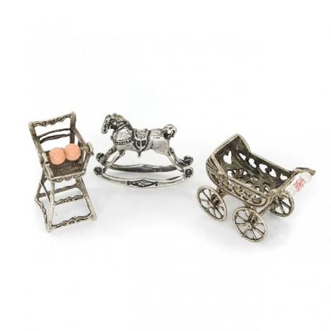 Colecție de miniaturi din argint: Simboluri ale prunciei și maternității
